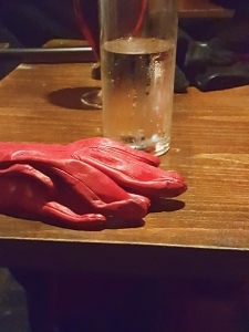 Leather gloves and drink
